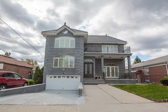 Beautiful oversized brick contemporary with 5 bds & 6 baths (2 Jacuzzis) totally reconstructed in 2015 like new. Enjoy luxury living in this spacious layout over 3300 sq ft including a 1st floor master suite. Custom designed open concept kitchen with SS appliances and high-end finishes throughout. 2 zone CAC, Spanish tile roof, outdoor terrace and a huge Florida sunroom. One block from PS 173 & minutes away from George Ryan middle school and Francis Lewis High. Too much to list, come & see