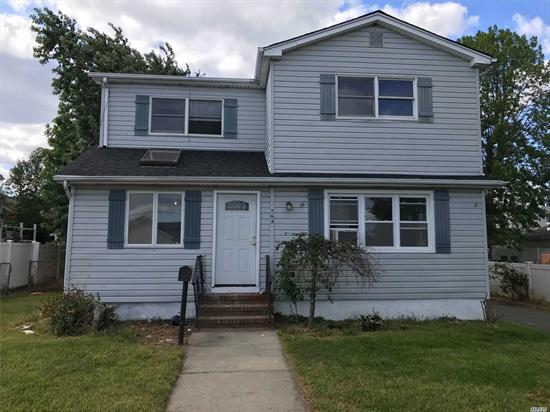Newly Renovated 5 Bedroom Colonial With 2 Baths, Detached Garage. New Carpet, Floors, Freshly Painted, Deck, Skylight & New Roof. Priced To Sell!!