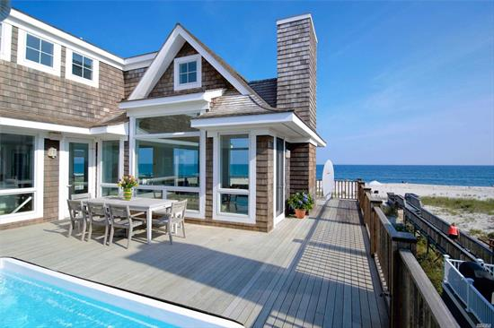 The ultimate beach house featuring 4 bedrooms and 4.5 bathrooms with spectacular ocean and bay views throughout. Watch the waves roll in from the bright and spacious living area or modern kitchen with high end appliances. The light filled master suite features ocean views from all angles, complete with a soaking tub to relax in. The first and second floors are accessible by elevator, and the third floor loft offers incredible water views. Lounge by the pool or on any of the multiple balconies ov