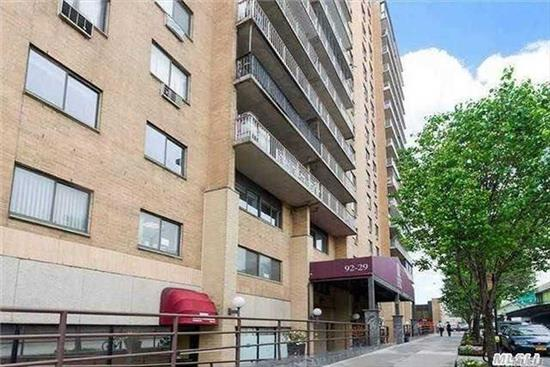 Perfect Investment at Queens Blvd Towers: Condo 2 Bed 1.5 Bath with a Balcony and Parking Space. Renovated unit with Hardwood Floors, Updated Kitchen and Bath. Washer/Dryer in the unit. This condominium has a 24 Hr Doorman and is conveniently located to the M/R Subway, Costco, Queens Center Mall, Rego Park Center and major highways for easy access in and out.