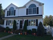 Gorgeous Colonial w Resort Backyard! Must See This Home! 2014 New Kitchen - granite/wood.Gas Cooking, Tankless Heat, So Much More.Solar Panels. No Flood Required (X Zone), Close to All!! LIRR, Shops, Etc. Reinhard, Winthrop, Grand & Kennedy!