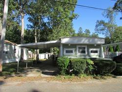 55+ Community in lovely Wading River. Priced to sell. Monthly fee is $511.18 and that includes the taxes, lot rent, water, cesspool, trash/snow removal. Private property with private driveway and carport. Two bedrooms and one full bath. Eat in kitchen. Close to stores, farmstands, wineries, Tanger outlet.