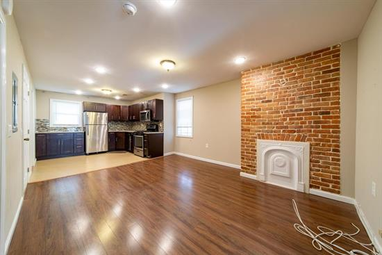 Located in the fast-growing section of MCGinley Square, this newly-renovated 2-family home offers two very spacious duplex apartments - perfect for large families or roommates. Each unit has 4 bedrooms and 2 full bathrooms with hardwood floors, exposed brick, stainless steel appliances including a dishwasher and microwave, and even central AC & heat! With easy access to public transportation on Monticello Ave and Summit Ave, you could get to Journal Square plaza in just a matter of minutes!
