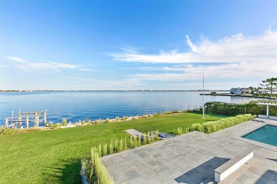 With panoramic bay views from the moment you enter this completely-renovated contemporary and 185 feet of new bulkheading, this turn-key home makes for the perfect Hamptons retreat. A brand new modern kitchen, large master suite with bay side balcony, 4 guest bedrooms and 3.5 baths, as well as an open living room with soaring ceilings and fireplace. Outside enjoy a gunite pool surrounded by expansive blue stone patio that leads out to the bay. Do not miss this opportunity!