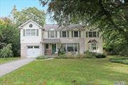 Beautiful colonial totally renovated in 2009 with open floor plan. Entry foyer to LR/DR family room with dual fireplace. Mud entrance leads to kitchen & garage, powder room 2nd Floor. Bright, 5 brs, 3.5 baths, eat in kitchen, full basement. PW train sticker. Roslyn schools.