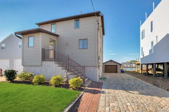 Boater's Dream! Canal Front Home. Raised & Renovated Inside & Out Post-Sandy. Situated on one of the South Shore's widest canals & only 5 houses from Bay. New Bulkhead, 3 Boat slips including Electric Boat Lift. Interior is Light & Bright,  Open Concept Kitchen/DR/LR, 1/2 Ba & mudroom w/ custom cabinetry. Upstairs includes Large Master w/ laundry area, Br, office & designer tiled, custom full Br w/ skylight. IGS, Tons of Storage.