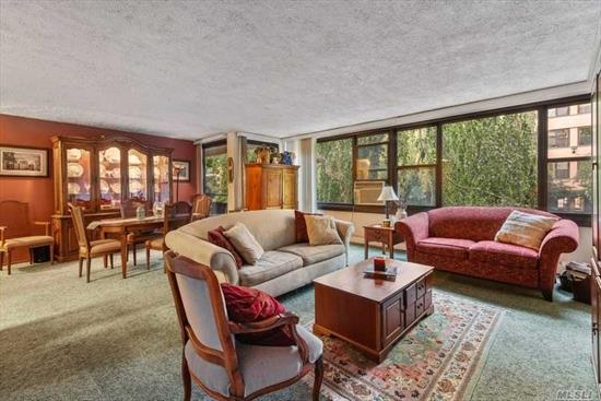 A Tranquil Tree-Lined View Awaits You. This Corner 1 Bedroom Unit Features An Open Concept Kitchen, Spacious Lr/Dr Combo With Window Wall, Updated Bathroom And Terrace Access From LR and BR. Parking Space Available For Transfer. Washer Or Dryer On Every Floor. No Dogs Allowed. Amenities Include: A Fitness Center, 2 Outdoor Pools, 3 Tennis Courts, Clubhouse And Restaurant. Walking Distance To Express Bus To NYC.