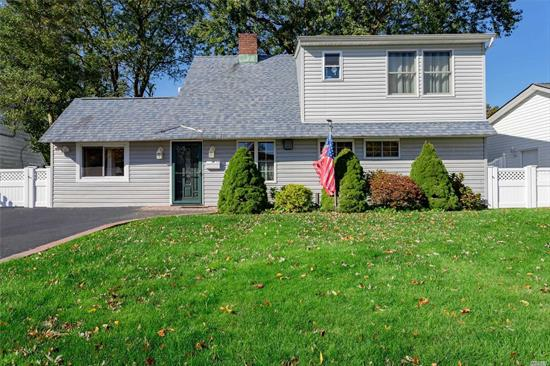 Move in ready 4BR, 2FBth expanded Ranch in Levittown!  Open floor plan, updated granite EIK w/custom cherrywood cabinetry.  FDR, LR w/fireplace, den/family room, master BR w/updated bath & WIC.  First floor renovated bath is 5 years old.  Partially dormered in 2014.  Second floor has new insulation, plumbing and electric.  Cherrywood crown molding, 200 amp electric, 2 zone heat, 10 year old roof, in ground sprinklers, private PVC fenced in backyard w/cement patio and shed.  Levittown SD #5/ Lot Size: 60 x 100/ Taxes w/STAR: $12,811/ Fuel: Oil/ Heat: Hot Water