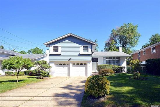 Lovely Port Washington Split, 4 Beds, 2.5 Baths With A Brand New Bathroom And A Large Entertainment Room On The Lower Level. New Gleaming Hard Wood Floors Through Out The House. Formal Dining Room. In ground Sprinkler System, Two Car Garage, Living room with Vaulted Ceilings And Updated Anderson Windows ., New Gas heating, Beautifully Maintained, Move In Ready! Convenient And Close To All