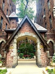 Beautiful, sun-filled apt in a classic pre-war Tudor building on a quiet tree lined street. A large entry foyer with glowing hardwood floors that can be used as office space leads to a contemporary eat-in-kitchen with plenty of cabinet space, stainless steel appliances; an over-sized bedroom, and an airy and bright living room that faces the front of the building. Also features high ceilings, arches, French doors&unique molding. Walk to LIRR, E/F (15 min), stores, restaurant and Forest Park.
