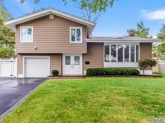 Charming Hollywood Split in the Heart of East Birchwood section of Jerico.  Newly Renovated 4 Bed, 2 Bath, Open concept, EIK, Hardwood Floors, Full Basement,  New Roof, Siding, Laundry Room, Blacktop Driveway. Syosset Schools District. Must See!!!