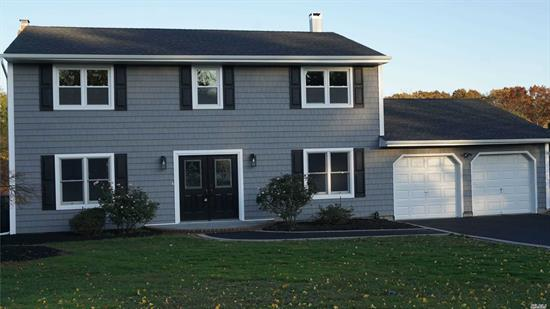 Completely Renovated Home with Brand new appliances, fixtures and high end finishes. Open Floor plan with fire place and gourmet kitchen. Just shy of 1 Acre with expansive composite deck overlooking park like grounds.