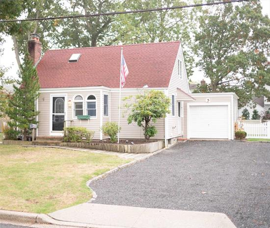 Just in Time for Fall.... Charming 3 Bedroom, 2 Bath Cape in the heart of Massapequa Woods! Perfectly set on a Quiet Mid-Block Location. Updated Eat in Kitchen and Bathrooms. Lovely Living Room w/Fireplace. Hardwood floors throughout. All on an 80 x 100 Lot! Close to Shopping, Schools, and Train. SD #23.