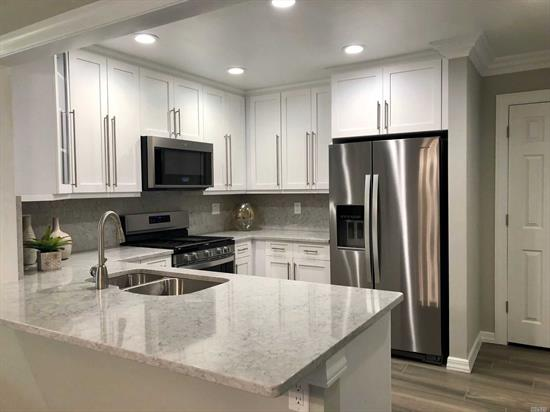 New Ownership/Fairfield! Modern Kitchen Cabinets.Quartz Countertop/Tile Backsplash/Plank Floor.Stainless Appl.GrayPaint/Carpet.Central Gas Heat/Air.Washer/Dryer.Club Room.Gym./Commuter Perfect/Near 495/LIRR.Rte 135, L.I.E/Southern State Pkwy.
