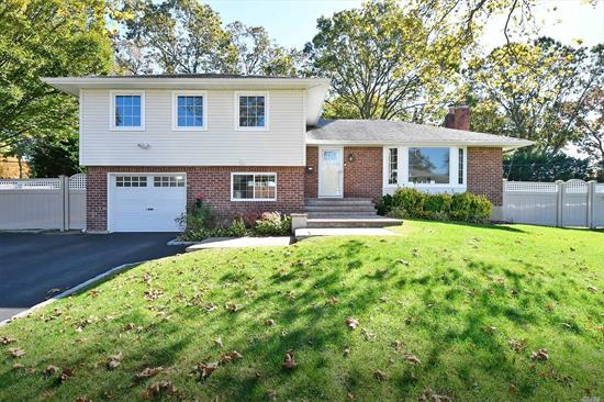 Desirable Melville Triangle Section! Immaculate, Pristine Move In Condition 4 Bd 4 FBth Split with Spacious Rooms and gleaming Hardwood Floors! Updated Heating System, Updated Tankless Hot Water Htr, Updated Roof and Windows, Updated CAC, and newer IGS. Green Audit Completed and this Home has a Certificate of Completion for the Home Performance with Energy Star. A Must See!