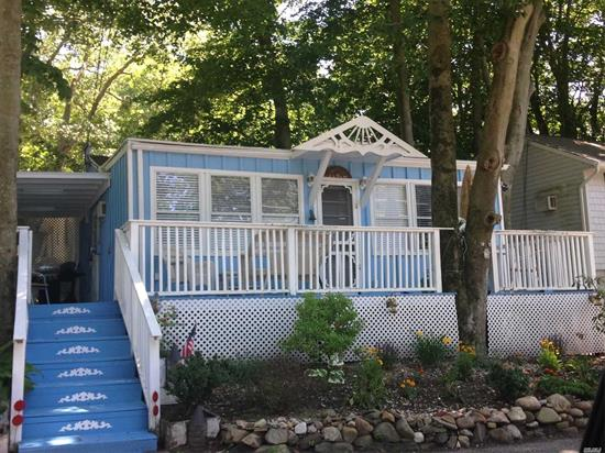 MOVE IN READY COTTAGE IN DESIRABLE WOODCLIFF PARK SEASONAL BEACHFRONT COMMUNITY OPEN APRIL 15-OCTOBER 15. PERFECT VACATION HOME OR SNOW BIRD LOCATION. UPDATED BATHROOM, FLOORING, ELECTRIC, SIDE DECK AND FRONT DECK FOR OUT DOOR ENTERTAINING, PRIVATE DRIVEWAY, SHED & MORE. WALK TO BEACH OR TO BAITING HOLLOW VINEYARD BOTH JUST SHORT STROLL AWAY.