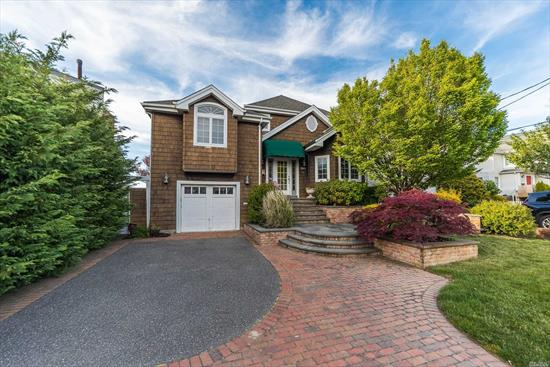 Spectacular Bayfront Gem with an Open Floor Plan and Water Views Throughout. Living/Dining Room with Fieldstone Fireplace, Sliders leading to the Heated In-Ground Pool. Chef's Kitchen offering Abundant Cabinets, Granite Countertops and Top of the Line Appliances. Family Room with Sliders to Paver Patio and Shower, 2 Large Bdrms and Rec/Guest Rm with 2 add Full Baths. Extravagant Bayfront Master En Suite with Balcony, Gas Fireplace and Huge Walk-In Closet. Sunsets, NYC Views, 2 Boat Slips,