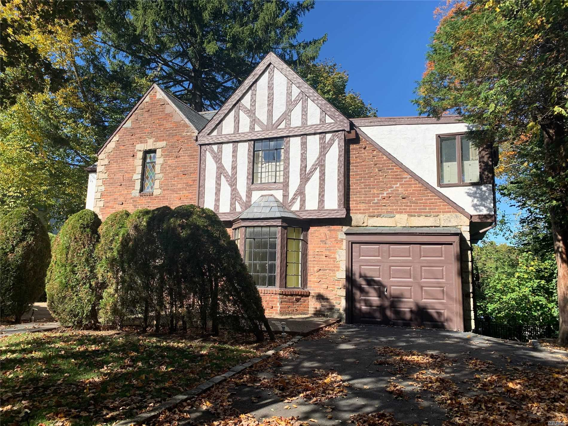 Classic South Strathmore Tudor.Oversized Bedrooms and Ground level Basement.Low Taxes.Award winning Manhasset Schools.