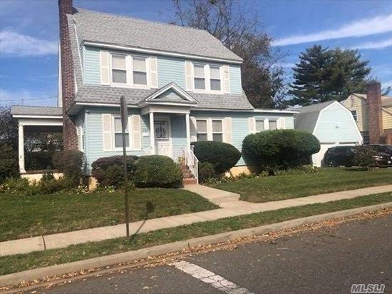 THIS HUGE CORNER LOT PROPERTY COLONIAL BOASTS 5 BEDROOMS, 3 FULL BATHS, 2 CAR GARAGE, UPGRADED ELECTRICAL, 2 YEAR OLD ROOF, HARDWOOD FLOORS, HUGE ATTIC, FULL FINISHED BASEMENT W/ FULL BATH AND OUTSIDE ENTRANCE! GREAT FOR A LARGE FAMILY! TREMENDOUS POTENTIAL! PRIDE OF OWNERSHIP! CLOSE TO TRANSPORTATION, SHOPPING, AND PARKWAYS! TOO MUCH TO LIST! WONT LAST! A MUST SEE!