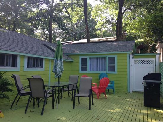 A Little Bit of Caribbean Flare in this Calypso Green cottage With Young Rf, Large Eat In Kitchen, W/New Refrigerator, Living Rm W/Vaulted Ceiling, Large Master Bedroom, Huge Deck W/Outdoor shower & additional 1/2 Bth accessed from outside, Private Driveway & More-Walk to Beach, Seasonal Home in Seasonal Community Open April 15-October 15. Land is leased and not included in sale. Cottage comes furnished.