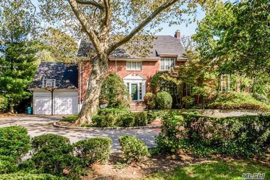 Brick Center Hall on Beautiful Property. Large Entry, Banquet Dining Rm,  Spacious Living Rm Opens to Sunlit Family Room with Cathedral Ceilings Leads into 2nd Den with Fire Place, Eat in Kitchen, Laundry room/Bedroom &.5 Bath. 5 Bedrooms and 3 Full Baths. Attached 2 Car Garage with extra high ceilings. Huge Circular drive and Property.