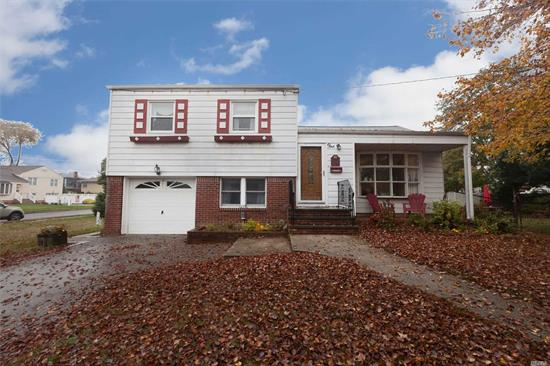 Beautiful 3 Br Expanded Split In Convenient Location. Vaulted Ceilings In Lr, 16X18 Family Rm, New Peerless Heating System, Cac, Prof. Landscaped, Rear Deck, 1 Car Att Garage.