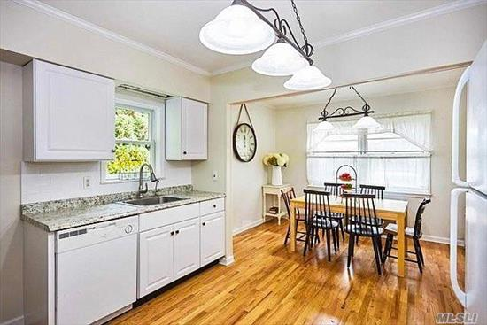Best Deal In Port Washinton! Pride of Ownership abounds this newly renovated cape cod home located in the Terrace. 4 bedroom 2 bath home boasts a brand new kitchen, new bathroom, new hardwood floors,  new windows, updated heating system w/separate hot water heater, 10 year roof, whole house water purification system and more.  Enjoy the newly sodded lawn in the oversized private backyard perfect for gardening and/or entertaining. Close to schools and transportation, this home is a must see!