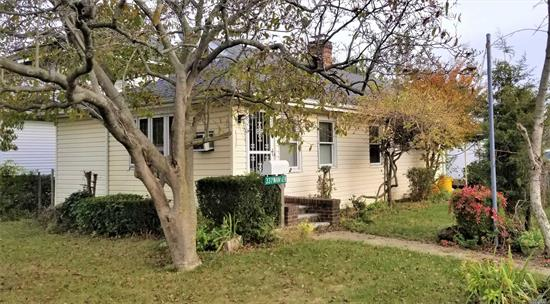 Contractor/Investor Special! House needs TLC. Create your own home. Cozy 2 Bedroom Bungalow in the heart of Inwood. Minutes to LIRR and Schools.
