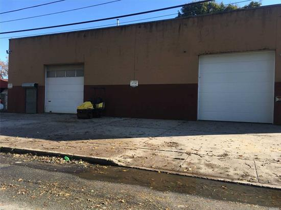 Approximately 1, 800 Square Ft. Commercial Garage (1, 500 Ground/300 Upper Mezzanine) With 20' High Electric Garage Door Leading to Open Space with 24' Ceilings and 2 Adjacent Storage Rooms and Bathroom on Ground Level and 3 Separate Offices (300 Sq ') on Mezzanine Level. 220 Electric, Gas Heat. Great For Warehouse, Storage, Distribution Facility.