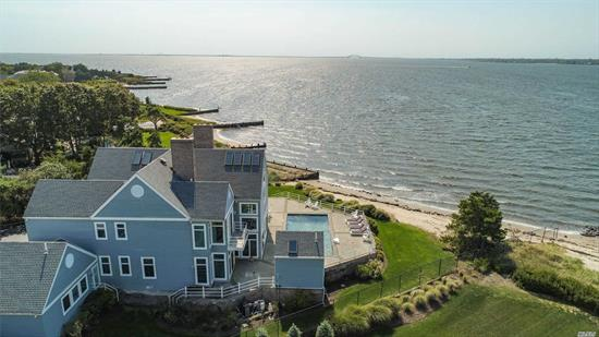 This One Of A Kind 6, 200 Sq Ft Masterpiece Is Set Back on Over an Acre of Waterfront Property. This Unique Home Offers One Of A Kind Views of The Great South Bay And Long Islands Beautiful Bridges. Fully equipped with Its Own Private Beach, In-Ground Pool Overlooking The Bay. Fully equipped Pool House With Wet Bar and Full Bathroom!!