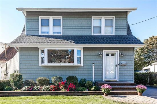 Expanded 4br, 2fbth colonial. Lynbrook SD#20. Large LR, FDR, EIK with granite counters and full bath on main floor. 4 large brs and full bath on second floor. Bonus space in the walk up attic. Finished basement, gas heating, beautiful floors. Home is set on over sized property, 15x30 semi-inground pool. Perfect for entertaining. Close to LIRR, schools and shopping.