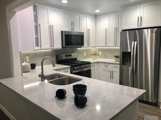Spacious residence. Kitchen with oak cabinets/white appl/upgraded bar counter.Tile bath.Terrace. WD.Plush crpt.Central gas heat/air.Club.Gym.Pool.Commuter perfect/Rt 495/LIRR/Rt 135. SD national #1 ranked by Niche survey. Prices/policies may change w/o notice.