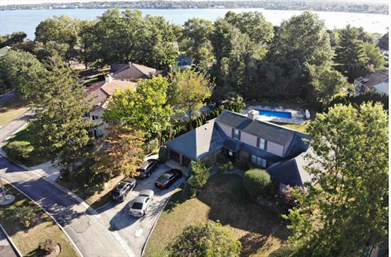 Stunning Colonial Nestled on Park Like Grounds w/Lots of Privacy in Beautiful Bayside Gables Private Community. Features Large Living Room, Formal Dining Room, Eat-In-Kitchen, Family Room, 4 Bedrooms, 4 Full Bathrooms, CAC and Hardwood Floors Throughout. In-ground Pool, Brick Rear Patio, Lot Size 80x112. Convenient to Shopping, Buses and Schools.
