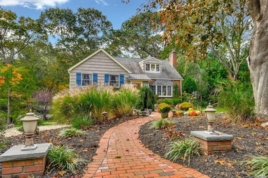 Storybook Home on a Spacious 1/2 acre property is located in the sought after Beverly Beach Association.Enjoy the Charm and light feeling of this 3 bedroom home with room for mom! Many updates include a New kitchen, CAC, updated baths, Newer Windows, lovely deck with automatic awning, Master suite w/ full bath and lovely balcony, new retaining walls, finished walk out lower level and more! Also enjoy the local private beach(fee), easy access to parkways, minutes to Northport Village! SD 5