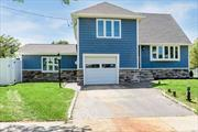 This open concept Split has been completely renovated, New kitchen W/ center island stainless steel Designer app, New baths, Nice size bedrooms, Large family Rm, Hardwood Fls, high hat lighting, updated electric, new heating and AC, New Windows, Roof, Siding, and Fence.