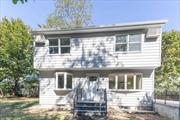 Newly Renovated Colonial In Miller Place Park - a Private Beach Community. Beautifully renovated kitchen - with new appliances and cabinets - and new bathrooms. New roof, siding, carpet, water heater & Boiler and refinished floors. Great place to entertain. This one Won't Last!