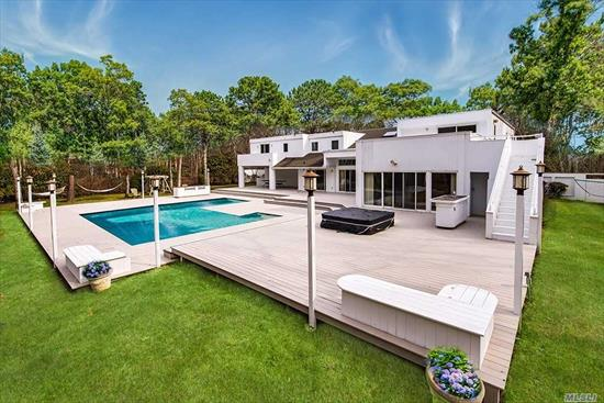 NOTHING MISSING FROM THIS PERFECT HAMPTONS COMPOUND! Bring everyone to this perfect summer retreat on over 2.5 acres on a quiet street. Steam room, tennis, hot tub, outdoor kitchen, large multi-level pool great for games or kids. The large finished basement will fit a pool & ping pong table. This 7 bedroom, 6.5 baths home is big enough for everyone. Here is your chance to own a compound in the quiet hamlet of East Quogue. Sale includes an additional lot.