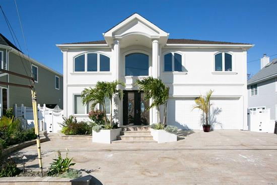 Miami Style Mansion, Waterfront Living At It's Best In Wantagh Mandalay Shores, Grand Canal Seconds From The Bay. Sleek & Sophistcated With A Two Story Hurricane Rated Glass Wall Living Room W/Panoromic Views Of the Water. Updates Galore With High End Finishes Throughout. Incl. A Grand Gone With The Wind Stairacase, State Of The Art Kitchen. Truly Phonemenal, Must See To Appreciate This Resort Style Home With An Amazing Entertainers Backyard W/Outdoor Bar, Floating Dock And Much Much More!!!