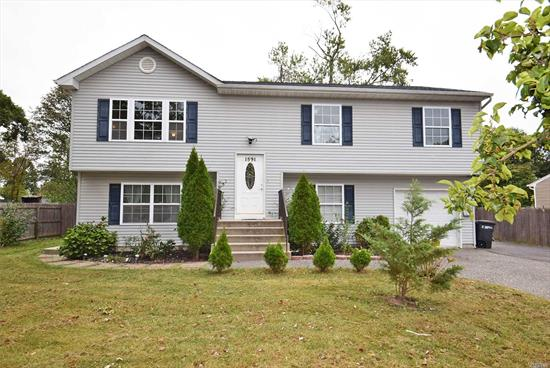 Very Nice And Spacious 6 Yr. Old Hi-Ranch In Excellent Conditions, Offering LivRm, Formal DinRm, Eik, 5 BedRms, 3 Full Baths, Master BedRm W/Full Bath, Family Rm, Hard Wood Floors And Carpet, Gas For Heat, Cook And Dryer, Deck, 1 Car Garage, Laundry Rm, Large Back Yard.