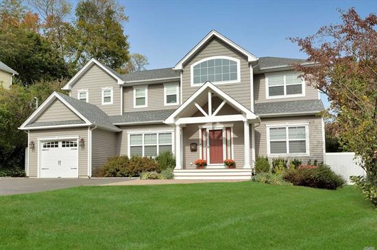 Welcome Home to this four year young Designer Colonial. with all the amenities you will need!  This residence features 4 bedrooms & 2.5 baths, Center Island Gourmet Kitchen, Lots of entertaining space with dual faced fireplace and access to private serene fenced backyard. Wood floors, closets galore, security alarm & more. Close to all