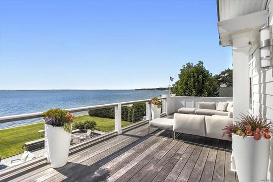 An enchanted garden surrounds this magical jewel box on 100' of Bay beach front. Breathtaking views and luxury touches. 4+ BR, 3BA, master suite with the perfect, double sided, spa like bathroom, and bayside patio. Gourmet kitchen with stunning Calacatta marble, living room with wood burning fireplace. Built in bar, full basement, outdoor shower, sleek blue stone patio with a fire pit, awnings, hurricane shutters, whole house generator, bulkhead and community dock space.