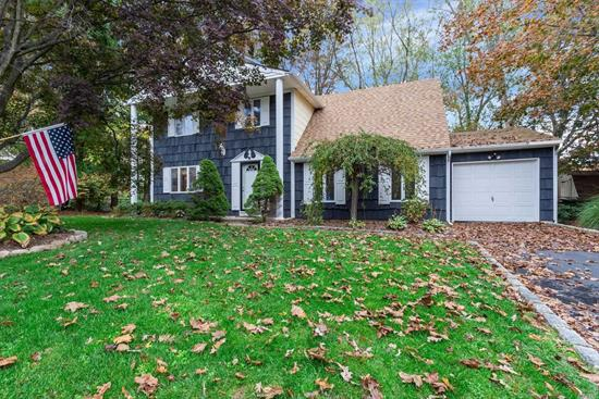 Beautiful Tree Lined Center Hall Colonial. Updated Bright Kitchen with Center Island. Large Dining Room. Step Down into formal living room. Den with half bath and garage entrance. Spacious Master Bedroom with Walk In Closet. New Deck overlooking 1/3rd acre property. A Must See.