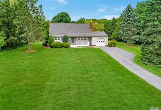 Charming North Fork Cape with Pool ~ Meticulous 3 bedroom 2 bath Cape with in-ground pool is set on an acre of park-like grounds. Close to hamlet shopping, transportation, the beautiful Nassau Point Causeway Beach and Indian Neck Beach and Vineyards.The perfect retreat!