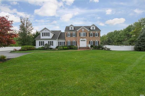 This Elegant Brick Colonial Evokes a Sense Of Grandeur at Every Turn. A Luxurious 6 Bedroom, 5.5 Bath Residence Features Fine Mill Work, Gourmet Kitchen Open to Family Room, Hardwood Flooring, & Inviting Sun Room. Park Like 2 Acres- Lavish Gardens, Inground Pool, Cabana, & Gazebo for Gracious Entertaining. Private Street Close to To Town. Finished Basement with Outside Entrance is Ideal Home Office for Professional Practice.