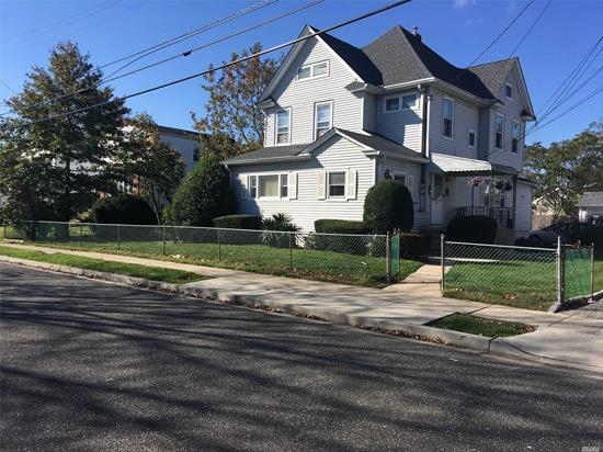 Don't miss this chance to own this 5 BR/2 Full Baths Spotless and Spacious Legal 2 Family , 3 Car Garage W/Chamberlain My Q Wifi, First Floor is 3 Bedrooms, Kitchen, FDR, Living Rm Bth, 2nd floor 2 Bedroom, Large EIK, Living Room, Bth Full Unfinished basement with high celings and sep ent./Fenced in 100x100 Huge Yard. Gas heating Close to schools, Transportation, Dinning, Beautiful Bay Park. Great Home for All or For Investors.Tax Reduction Assessment in Hand Take Off.$1240.22 Basic Star Program