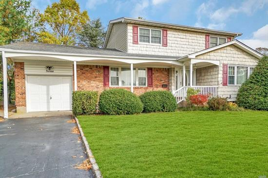 Home located in sought after Sayville community with award winning schools. House is very large & has versatile floor plan. First floor has huge living room & dining room with large EIK. Also has a room that could be den/office possible 4th bedroom & full bath. Upstairs has 2 nice size bedrms, Full bath & enormous master. Basement has large den area & possible 4th or 5th bedroom. Also has wonderful screened in patio perfect for entertaining & attch 1 car grge. Do not miss this amazing home!