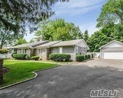 One Of A Kind Beautiful 4 Bed/3 Full Bath Ranch, With Full Finished Basement W/ Built-In Wet Bar OSE & Built-In Murphy Beds. With 2 Master Bedroom En-Suites Both W/ WIC's! Situated on Shy 1/3 Acre Property, Pretty Eat-in-Kitchen With Bar Stool Seating, Gas Cooking, Wine Fridge & Outside Entrance, Spacious Dining Area, Formal Living Room W/ Fireplace & Family Room. All Updated In 2005 Through 2012! Perfect For Extended Family, Poss Mother/Daughter W/ Proper Permits. Oyster Bay-E. Norwich Schools.