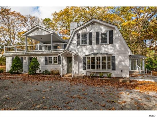 Newly renovated Nassau Point Gambrel style home, Beautiful Gourmet stainless Kitchen with a Viking Double Oven, six burner Stove. Large open floor plan, anchored by a center Island, overlooks Living/Dining, and glass enclosed sunroom. A Grand First Floor Master Suite plus two additional En-Suite bedrooms on the second floor. Yard has room for pool, detached garage could double as a pool house. Two private sandy bay beaches, and a second story deck. Great home for entertaining!