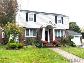 Mint 4 Bedroom Colonial. Updated Large Eat in Kitchen, Formal Dining Room with Fireplace, Spacious Great Room with Fireplace, Office/Mud Room,  2.5 Baths including Master en suite. New Central Air. Hot Tub. Lynbrook S.D. #20. Marion St. Elementary and South Middle School.