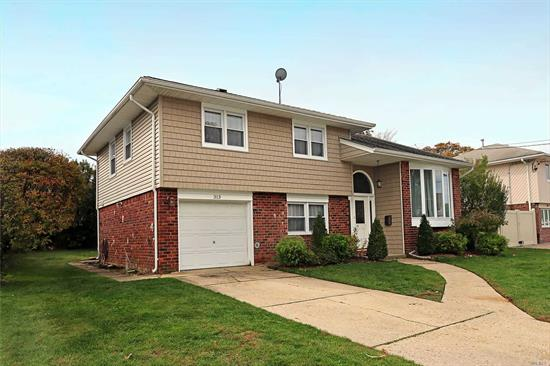 Beautiful Mid-block home, completely renovated NEW in 2014. Everything from siding to windows, doors, landscaping, etc. was done. This home has 2 full baths, CAC, GAS, and is Centrally located to parkways, parks & recreation, shopping and more. Farmingdale Schools. NOT TO BE MISSED.